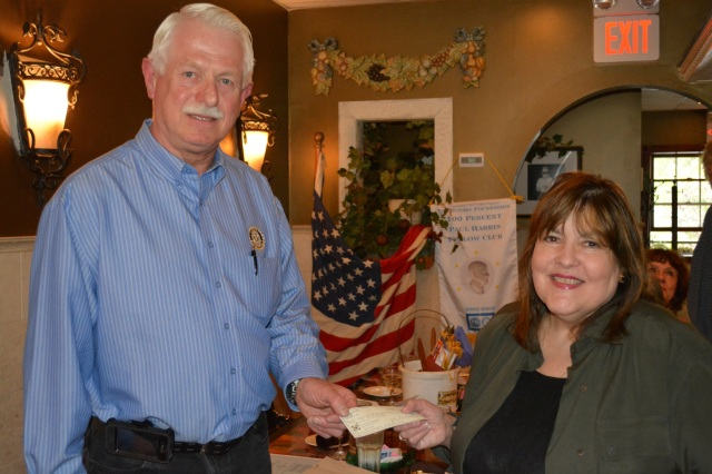 Edward Kostrowski of Rotary presents a check to Laraine Barach, chair of the Art Advisory Committee