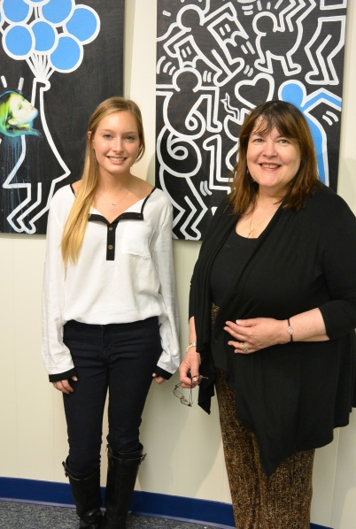 Jackie San Fillipo  and Larraine Barach, chair of Art Advisory Committee,  in front of Jackie's artowrk