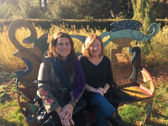Cathy Scorcese and Kathi Hecht, Art Advisory Committee members on a Betty Woodman bench