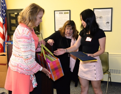 Judy Kramer and Laraine Barach present Jennifer Guo with her scholarhsip award