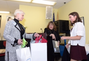 Orna Greenberg AAC hands Julia Hames her awards