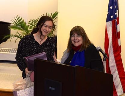 Eden Elder receives her award from Laraine Brennan Barach