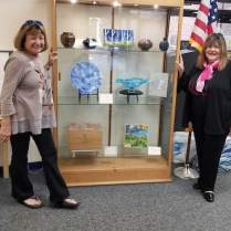 Kathi Hecht with her glass art and Laraine Brennan Barach, AAC Chair
